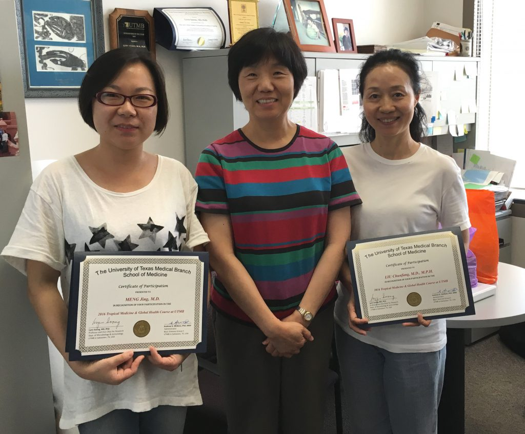 Angeline (left) and Kathleen (right) show off their certificates from UTMB with Professor Lynn Soong.