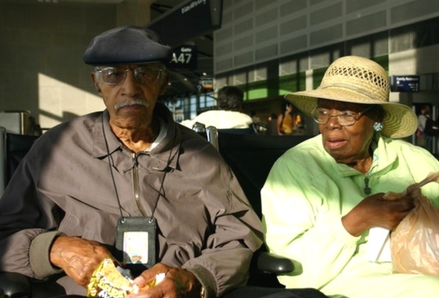 Senior travellers in an airport