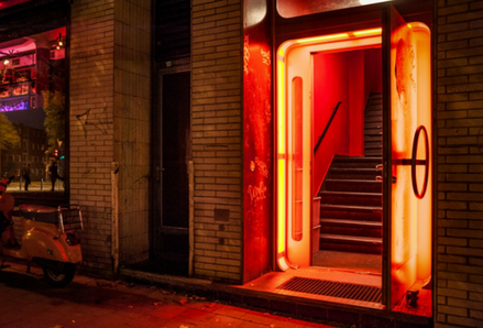 Open door with red light. Photo by Mali Maeder.