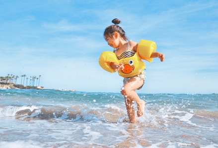 Child playing in the ocean. Photo by Leo Rivas, Unsplash.